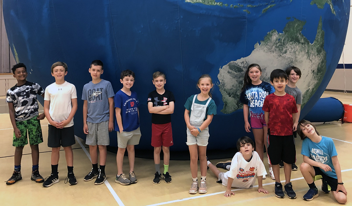 2020 Roswell Summer Day Camp participants and the Earth Balloon the city uses in its environmental education efforts.