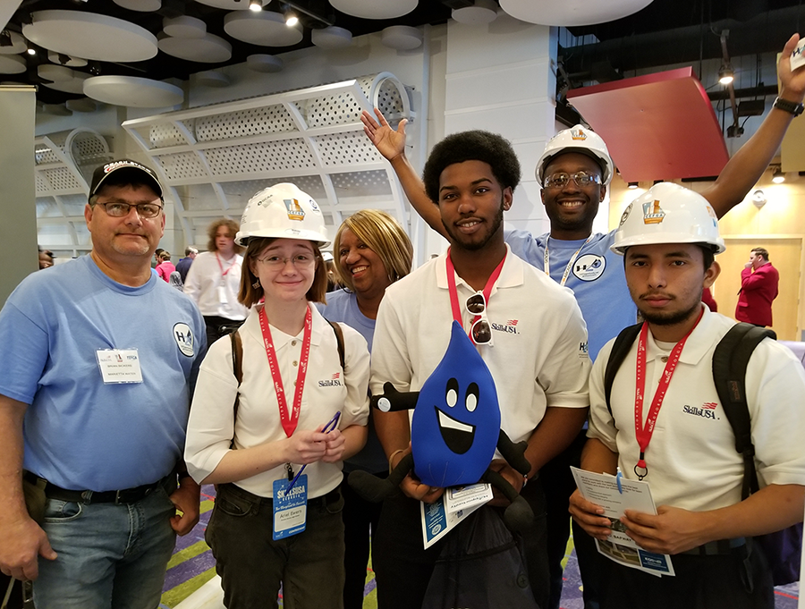 "Three students and H2Opportunity representatives from Marietta, Atlanta and Arcadis, Inc. at the ""World of Water"" booth as part of the 2020 Construction Education Foundation of Georgia Expo."